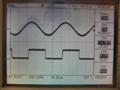 10kHz 8R square wave, shows phase shift. Bottom trace is amplifier input from the signal generator, top trace is amplifier output. The amplifier filters out all the harmonics necessary to make a square wave and turns the wave into an almost perfect sine wave.